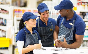 group of hardware store workers discussing work