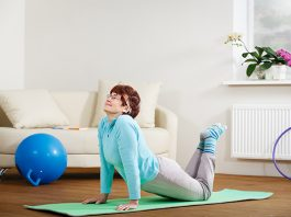 Woman exercises at home