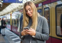 Woman looking at her phone on a platform