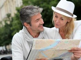 Middle aged couple look at map on holiday