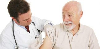 Old man gets a flu shot