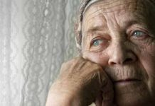 Old woman looking sad