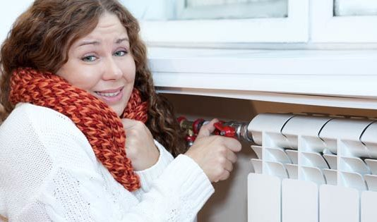 Cost of heating, woman turns on radiator