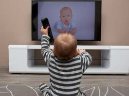 baby in front of tv